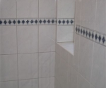 009-shower-using-white-tile-with-blue-diamond-border